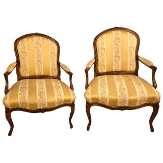 Pair of French Louis XV Style Walnut Arm-Chairs Bergeres in a Fine Upholstery For Sale