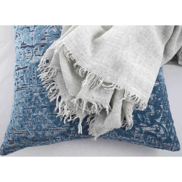 Our best seller throw comes in three delicate colors: Mauve, Denim and Ice Gray. Each piece is individually dyed in Italy....
