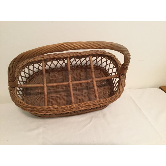Vintage basket can be used as a magazine rack.