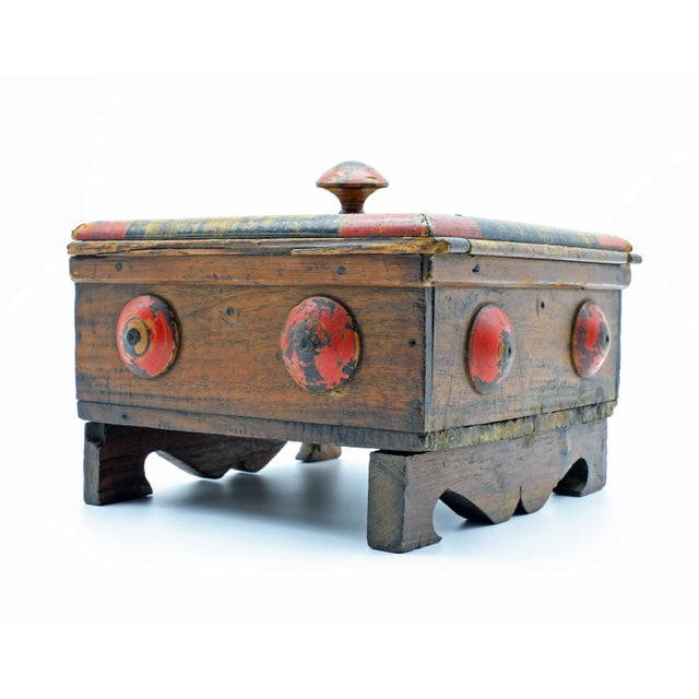 This beautiful antique wooden spice box from Afghanistan is hand-painted with touches of yellow, red and black. It has...