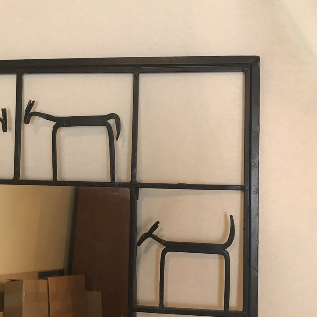 Rustic mirror surrounded by small animal figurines