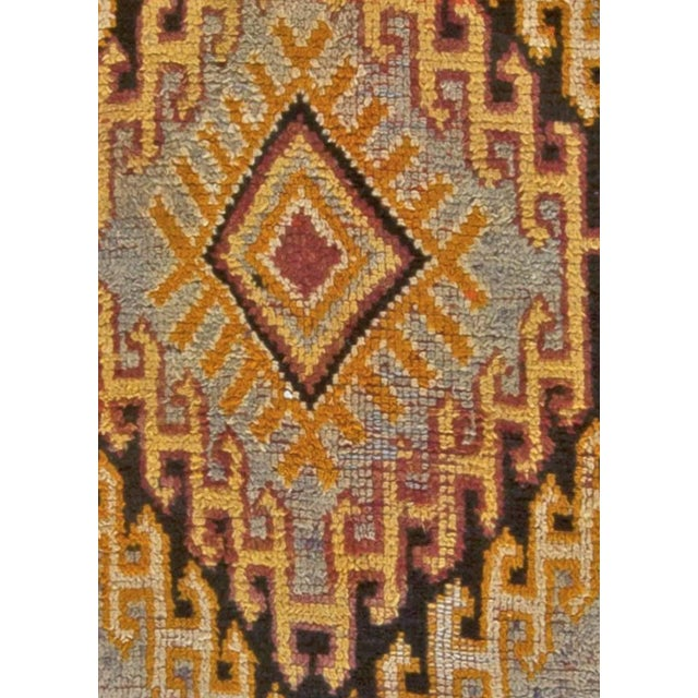 """Vintage Moroccan rug Size: 5'9"""" × 14'0"""" (175 × 426 cm). This vintage Moroccan rug features a bold design of a diamond..."""