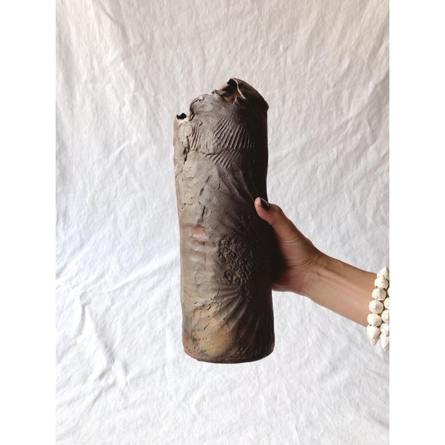 """Unique, intricately imprinted, and one of a kind vase in the style of traditional Raku firing. Signed """"Madeleine."""""""
