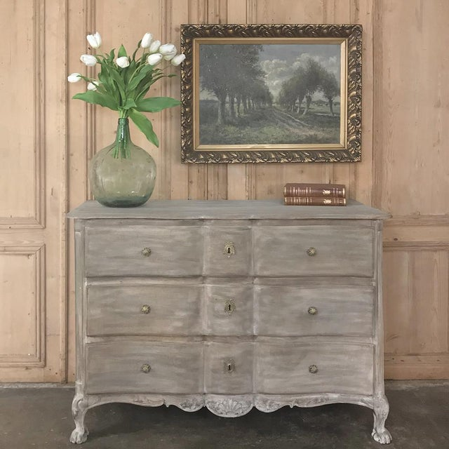 18th Century Country French Whitewashed Oak Commode features graceful lines in the shape of an archer's bow, called en...