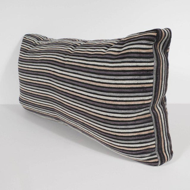 This sophisticated pair of striped rectangular pillows features hues of champagne, oyster, smoked platinum, and charcoal...