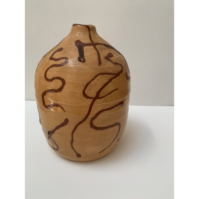 Stunning MCM weed pot with a signature on base. There are a few paint chips along rim to vessel. Vintage good to fair...