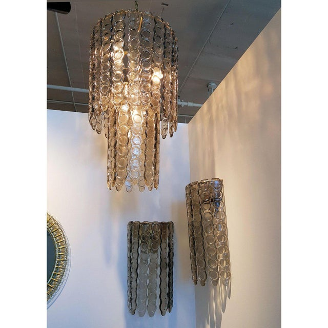 Large Murano smoked glass chandelier, with brass frame, chain & canopy (around 19 in. high)in the style of Mazzega. Italy,...