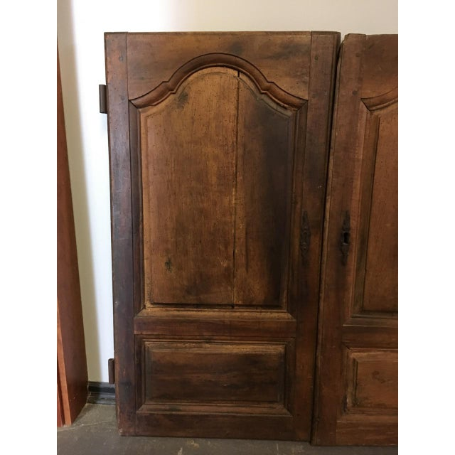 Pair of Antique French 18th Century Walnut Cabinet Doors. There are original hardware components including keyholes and...