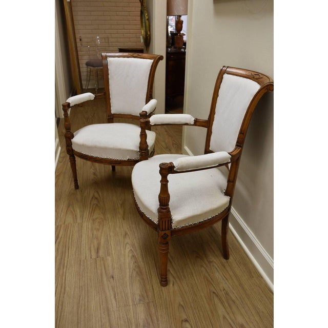 This pair of Directoire Style Armchairs feature a lovely warm walnut finish with a scrolling back. The fabric shown is a...
