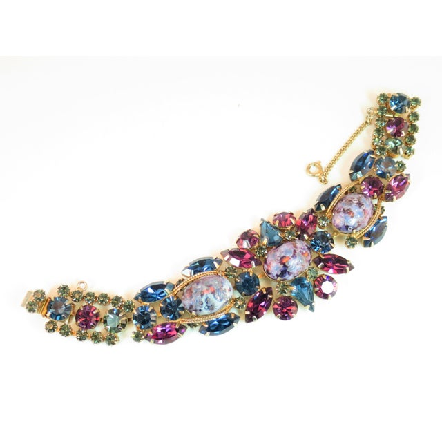 """Offered here is a DeLizza & Elster Juliana gold-plated bracelet featuring their famous """"Easter egg"""" stones. It is created..."""