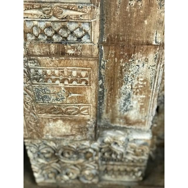 Antique Indian teak door and frame from a Rajasthan haveli, this is an important element of very fine quality, with superb...
