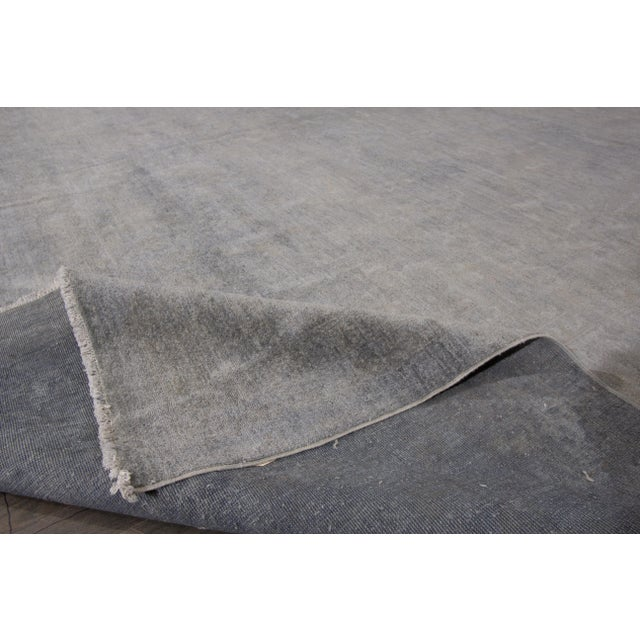 """A 21st century modern hand knotted wool overdyed rug with a grey allover design. This rug measures 13'9"""" x 20'0""""."""