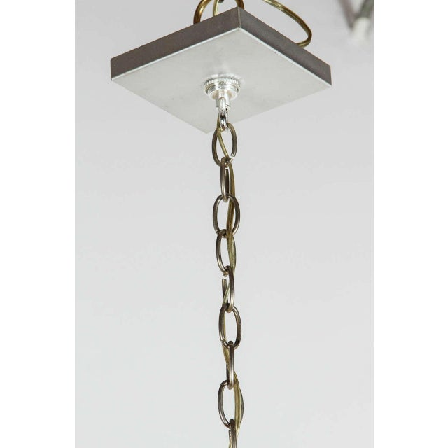 Brushed aluminum six-arm chandelier in the style of Kalmar with up and down lighting.