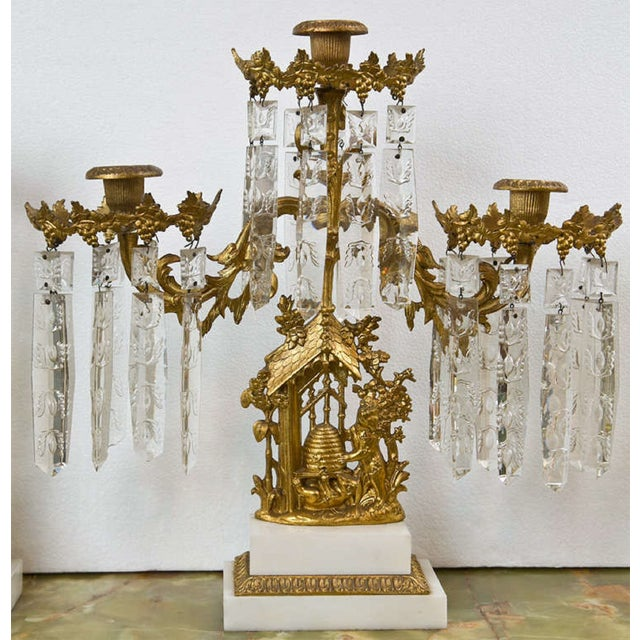 Set of 3 French Belle Epoque Style gilt-metal candelabras, the center piece has three arms, the other two each has one...