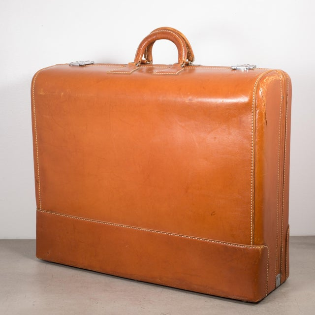 "ABOUT This vintage luggage named ""The Colonel"" has stitched leather throughout and silver locks that work properly. The..."