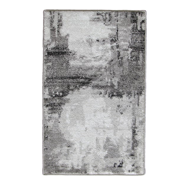 Inspired by the contemporary look of abstract art, the Gray Abstract Rug will modernize any decor. Bring simple luxuries...