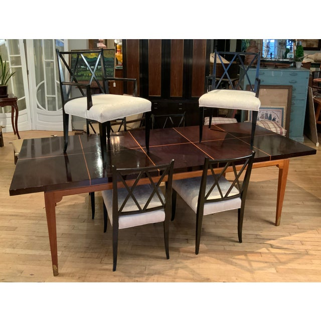 A beautiful and elegant extension dining table designed by Tommi Parzinger for Parzinger Originals, circa 1950. the base...