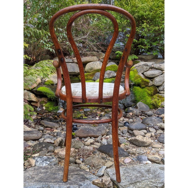 I'm thrilled to offer for sale this exquisite and spectacularly rare bentwood bistro chair by the highly esteemed Michael...
