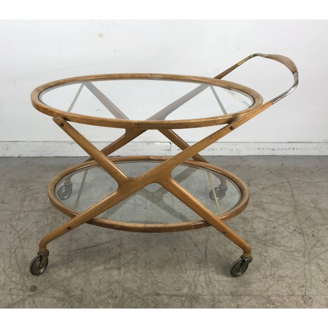 Classic Mid-Century Modern 1960s bar cart. Tea trolley designed by Cesare Lacca, glass shelves and brass details, original...