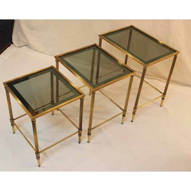 1950's solid brass Italian nesting tables with glass tops. These pieces are in good vintage condition with some wear due...