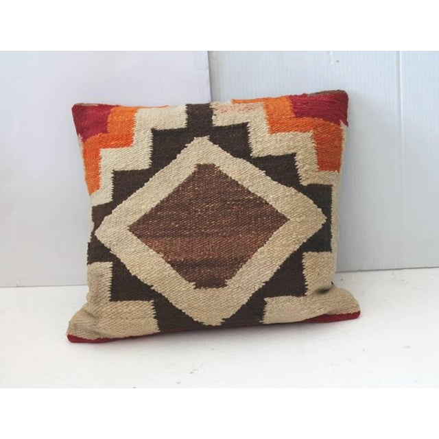 Fantastic and early pair of Navajo Indian weaving pillows. This vibrant and simple pattern weaving has brown cotton linen...