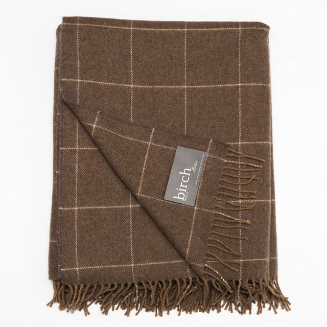 This Caramel Windowpane Simply Birch Throw is made of 100% lambswool, is 78″L x 57″W and is composed of a caramel color...