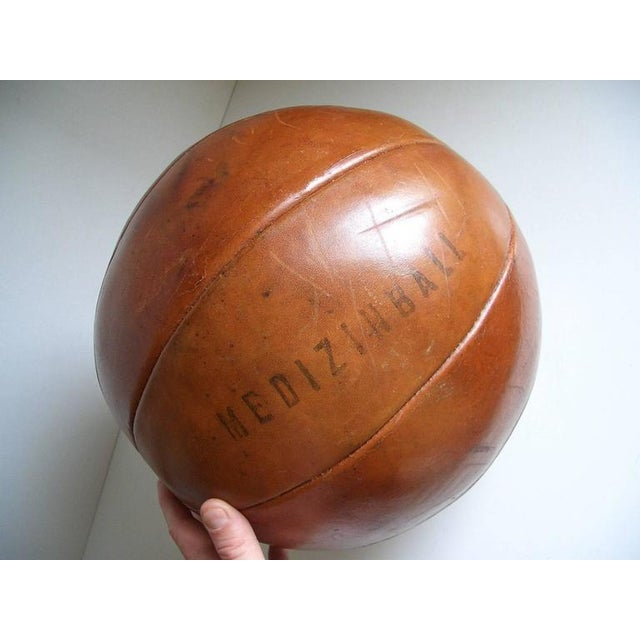 An original patented leather medicine ball with a branded manufacturer mark reading Platura.