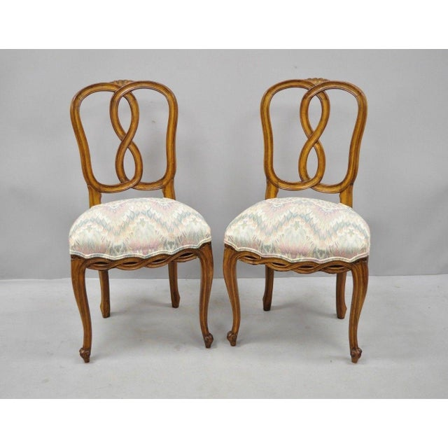 Set of 6 Vintage French Provincial Pretzel Back Spiral Carved Dining Chairs. Listing includes six side chairs, carved...