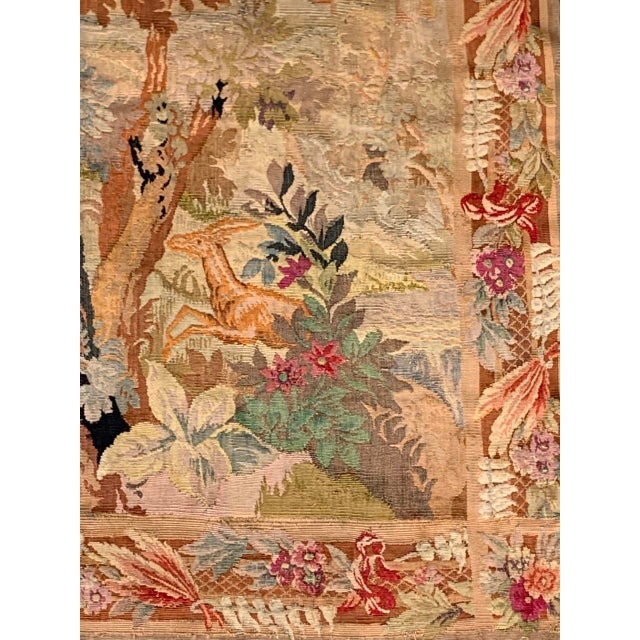 """Antique French wool tapestry featuring a woodland or """"des bois"""" forest scene with a deer and an exotic bird enjoying the..."""