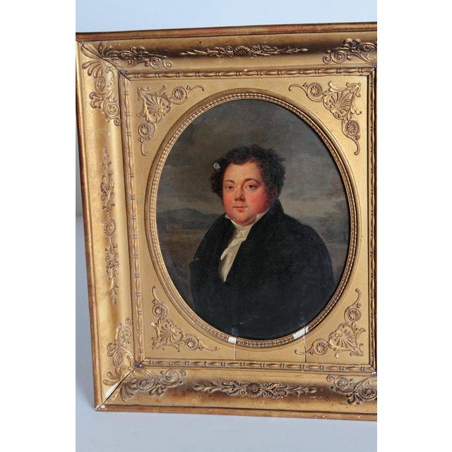 A fine example of an antique ovular oil on canvas. The artwork depicts the image of a man dressed in black. Extensive...