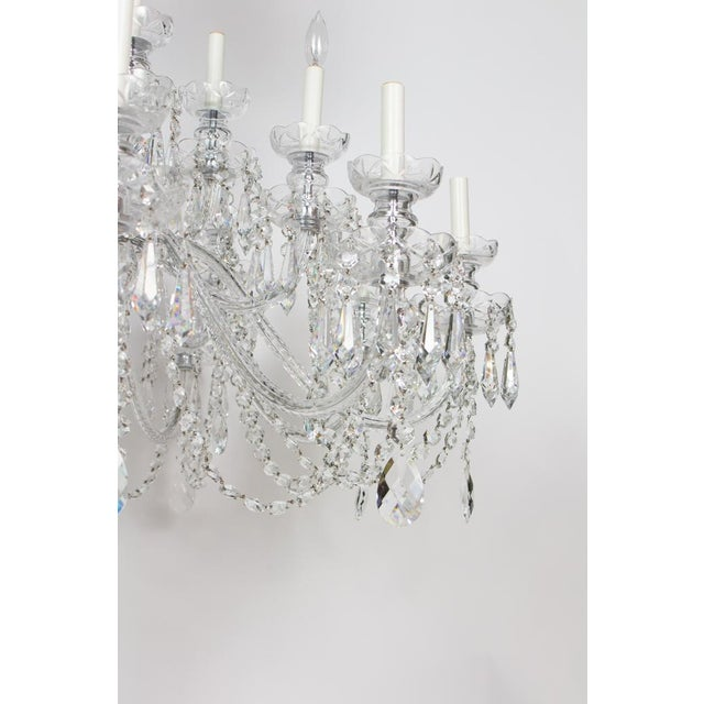 Multitiered bohemian crystal chandelier. Adorned with chains and spears. New