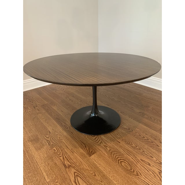 "Eero Saarinen for Knoll Tulip dining table. 54"" round. Walnut veneer top. Black painted aluminum base. I am the 2nd owner,..."
