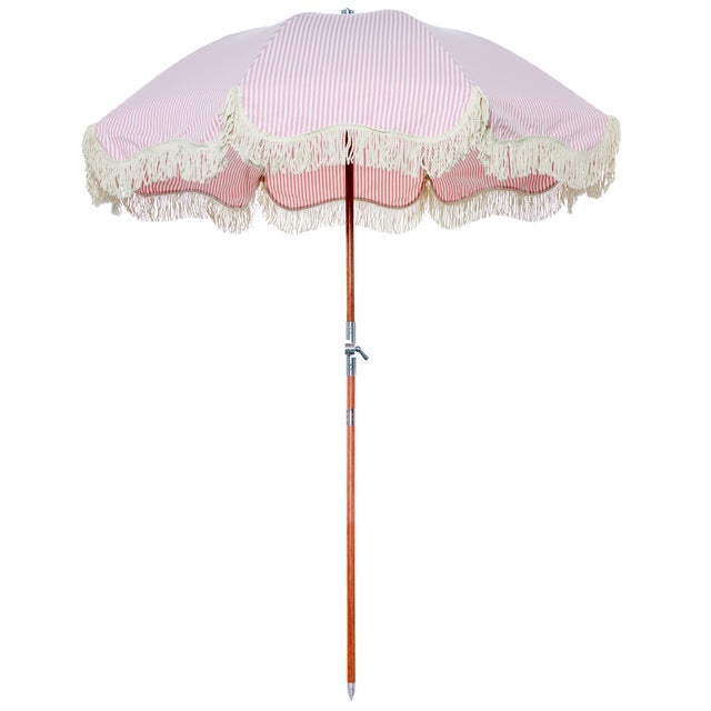 The timeless and always classy pink and white stripe umbrella is a must for any oceanside adventure. Part of our Premium...