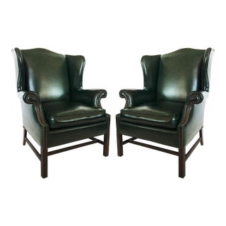 Pair of Chesterfield Tufted Dark Green Leather Wingback Chairs For Sale
