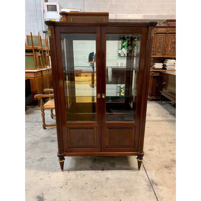 """French antique Louis XVI style bookcase / vitrine """"bonnetiere."""" 1910s made of mahogany ,the mahogany wood has been..."""