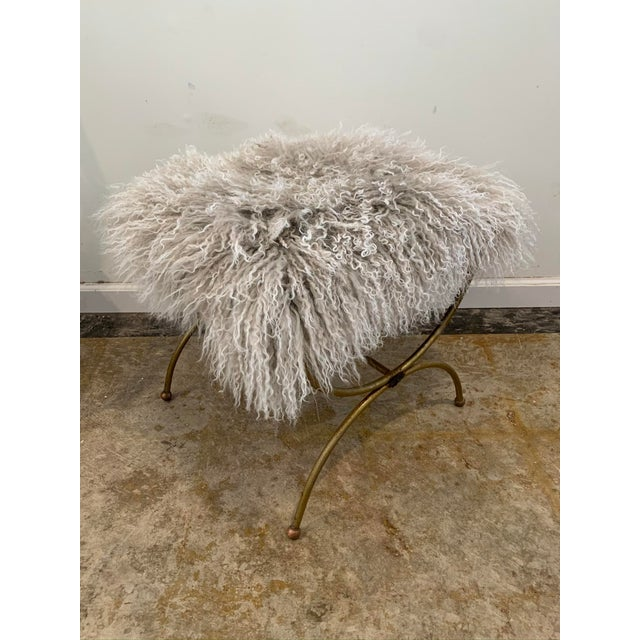 An update on a vintage vanity stool. We've reupholstered it with this fun mushroom tone mongolian mohair for a luxe and...