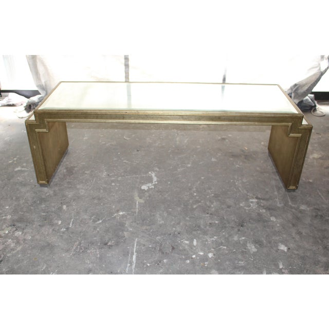 Original Art Deco style coffee table with original bevel antique mirror. The piece was produced in the mid 20th century.