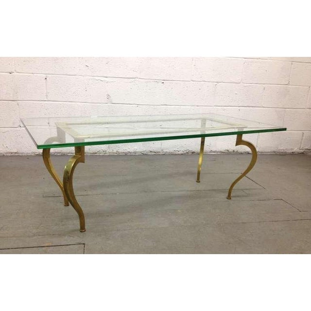 French bronze coffee table with thick glass top and nicely shaped legs by Maison Ramsay.