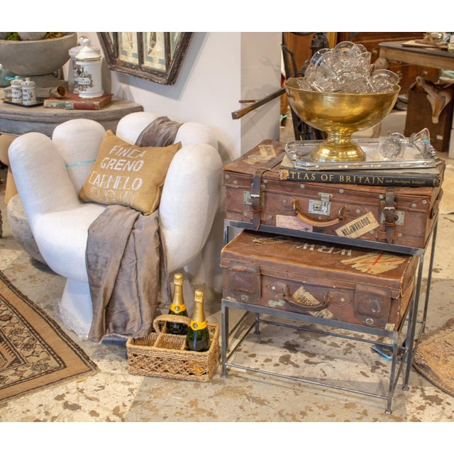 This set of nesting tables has been created using two English leather suitcases, each with a custom base. The underside of...