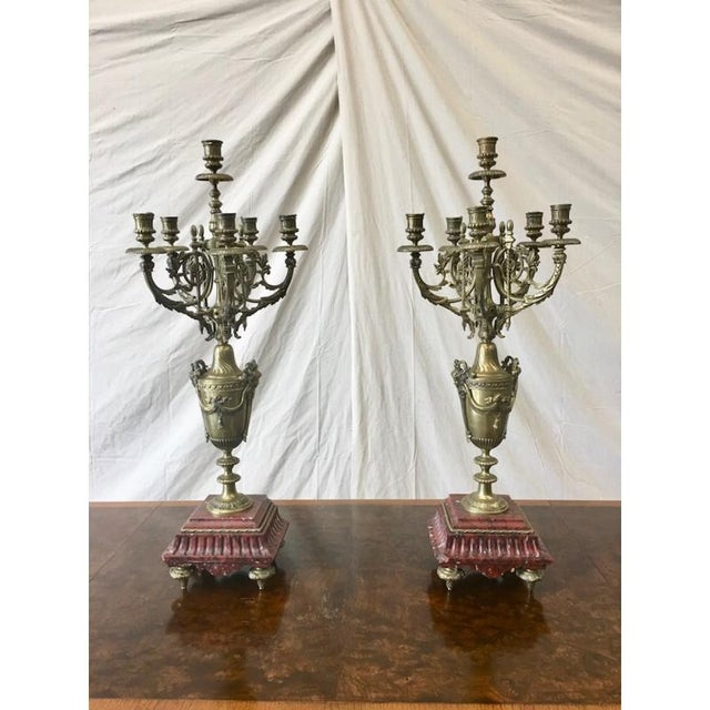 """Fabulous pair of French Louis XV candelabras, featuring ornate arms, and """"rouge"""" marble base. Dimensions: 29.5"""" T. 11"""" W...."""
