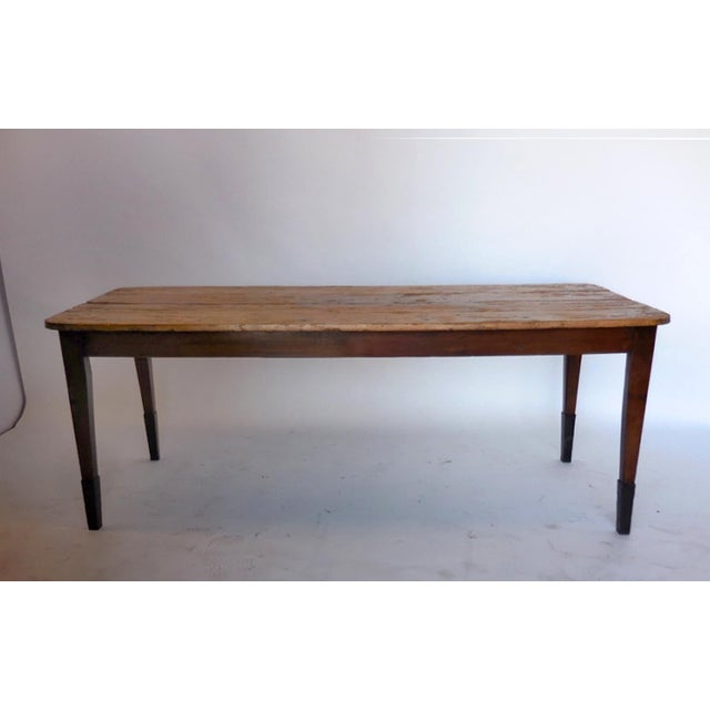 19th century New England country pine table with iron leg extensions. Short apron so there is plenty of leg room....