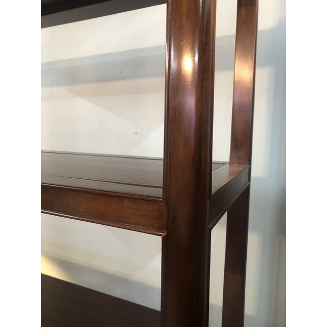 Stately wood shelving unit with 5 shelves and 2 drawers at base. Clean lines. 4 shelves pop out. Dark grain tone