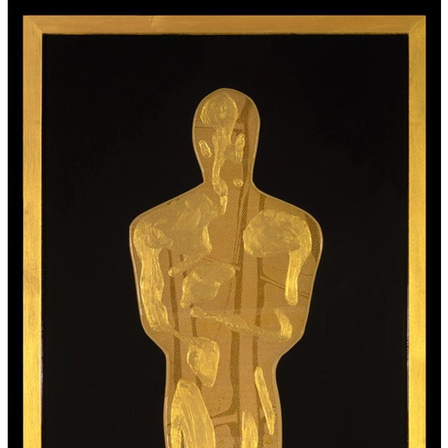 Golden Oscar by Mauro Oliveira, signed. Acrylic paint with automobile vinyl tapes, covered with resin on wood frame. A...