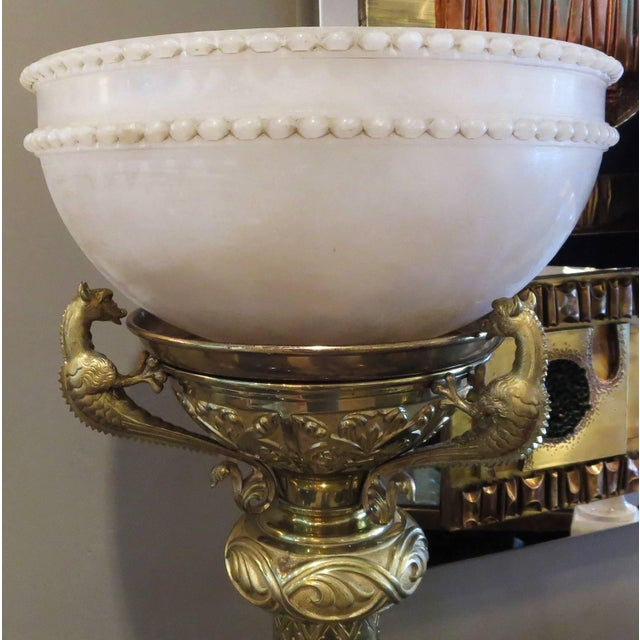 This elaborately designed lamp was most likely seen in a hotel lobby or theater foyer after the turn of the century. The...