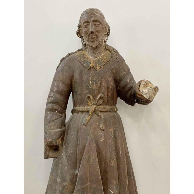 This is an antique wood statue of San Isidro with the original paint. There is damage shown in the pictures. The...