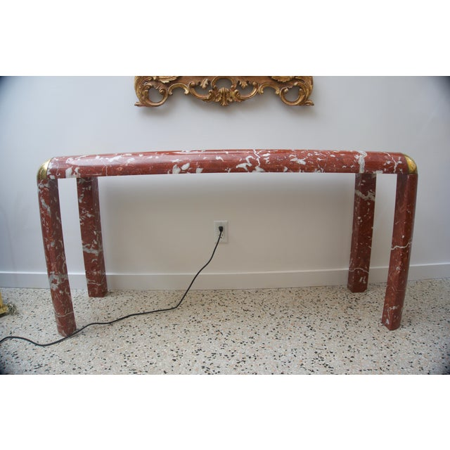 This stylish console table is by the iconic designer Karl Springer and was acquired from a palm beach estate. For trade...