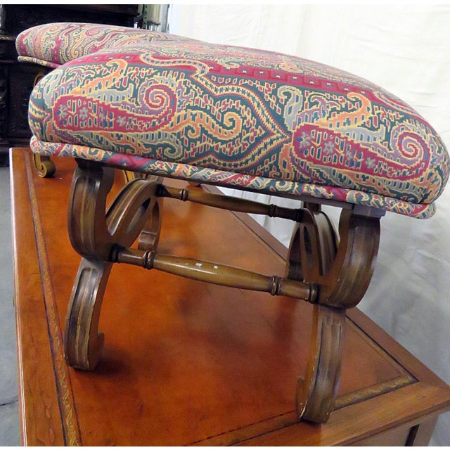 Pair of Regency style footstools with tapestry upholstery on wooden base.