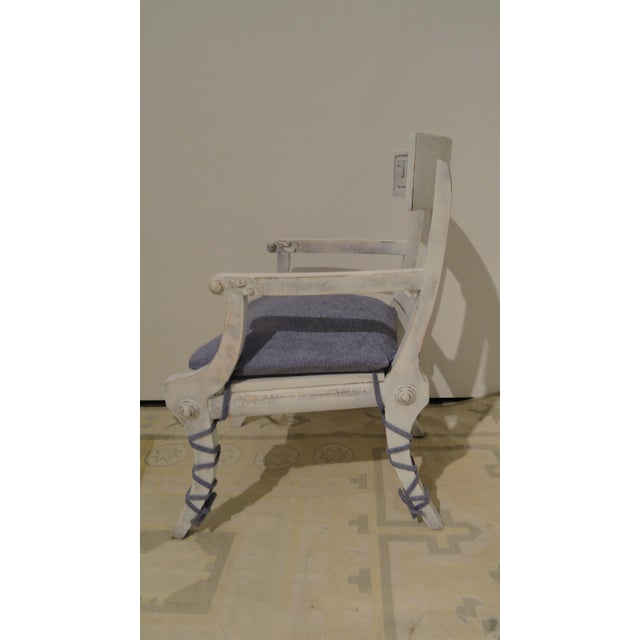Classic klismos armchair in a custom hand painted and hand-rubbed finish. Custom loose cushion with leg strappings....