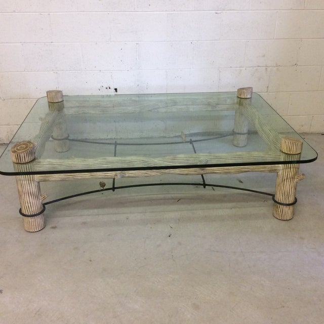 This is a conversation piece! Fantastic vintage faux log with iron trellis base and one-inch thick glass. I am told by the...