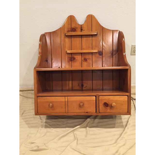 1950's Pine telephone shelf unit came with a 50's houses I bought a while back. A neighbor told me that the eccentric...